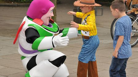 Jackson, four, dressed as Woody from Toy Story meets Buzz Lightyear during the Stevenage town centre