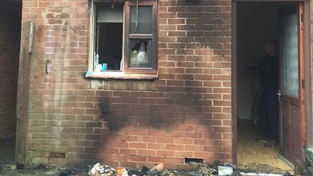The fire started in the back garden of the home in Alexander Gate
