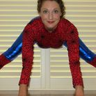Sarah doing her yoga moves as Spiderman.