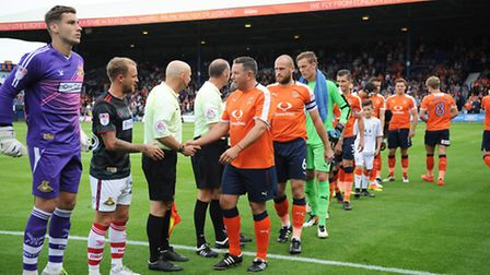 Lifelong Luton fan Paul Bacon from Stotfold shakes hands with the referee at the head of the Luton t
