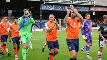 Lifelong Luton fan Paul Bacon from Stotfold, centre, leads the team out before Saturday's game again