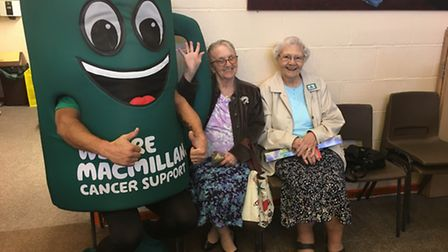 Macmillan mascot Muggy with Eileen Spillane, 81, and Rose Haggett, 91, at the Christ the King church