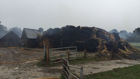 Around 950 bales of hay caught alight in the fire at Angels Farm, Offley. Picture: @SCHutchinson_ vi