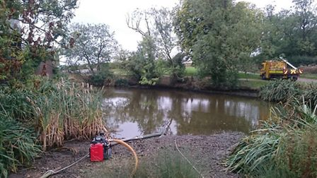Firefighters had to use water from this lake to tackle the blaze at Angels Farm in Offley. Picture: