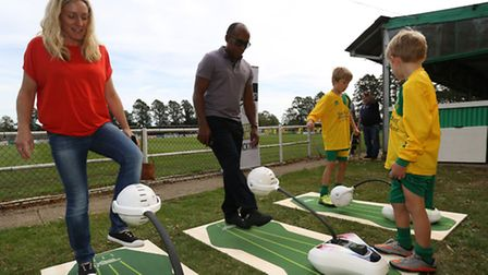 Kerry Haynes, Anthony Hamilton and Jacob Haynes, nine, have a go on the Kick Trix at Hitchin Town FC