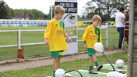 Jacob, 9 and Archie Haynes, 6 have a go on the Kick Trix at Hitchin Town FC family day.