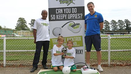 Anthony Hamilton, Jacob, 9 and Archie Haynes, 6 and Hitchin Town FC manager Mark Burke with the Kick