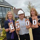 Taylor Wimpey Sales Executives Cheryl Pilborough (left) and Jeanette Stevens (right) with Luke Newma
