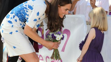 Evie being greeted by the Duchess of Cambridge