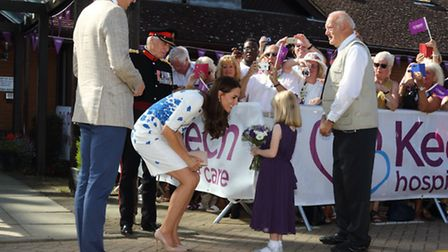 Evie Farmer presenting her bouquet to the Duchess of Cambridge