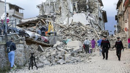 Houses collapsed in Amatrice, central Italy, as a result of last week's earthquake. Photo: ANSA/Mass