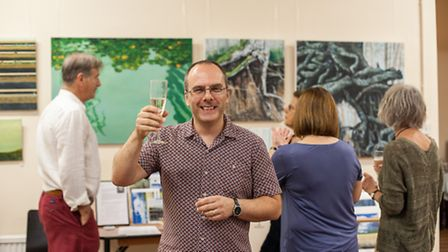 Hitchin painter Mike Rollins toasting the success of the private show before the start of the exhibi