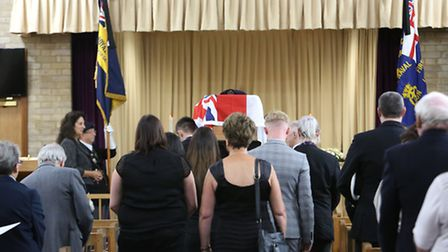 George McDowell's coffin is carried into the crematorium.