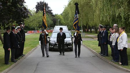 Royal British Legion and other community members form a guard of honour for Royal Navy veteran Georg