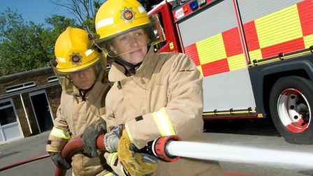 A female member of the Bedfordshire Fire and Rescue Service at work.