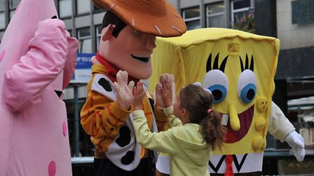 Children meet cartoon characters at a Woody's Wild West event in Stevenage town cente.