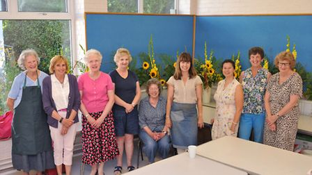 Participants in the summer flower arranging workshop at The Settlement run by tutor Helen Allen from