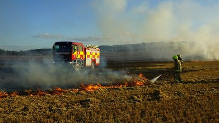 Fire crews tackled a field blaze last night and prevented it from spreading to Keech Hospice Care in