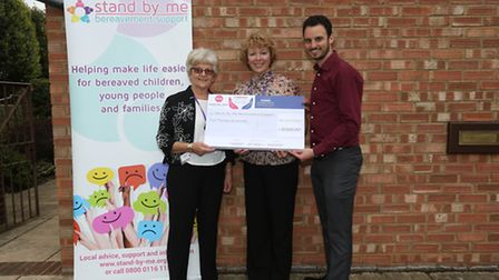 Stand-By-Me's Sandra Blacker and Karen Stanton receive a cheque for £2,000 from Comet news editor Ni