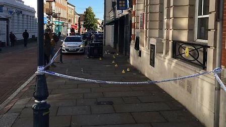 The police cordon up in Hitchin High Street after a man was stabbed in the leg during the early hour