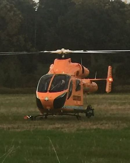The Magpas air ambulance lands nearby after a crash in London Road which has left the driver in a se
