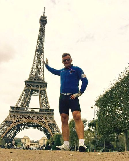 Dave Sharp points at the Eiffel Tower during his and Garry Tucker's cycle ride from Baldock and Pari