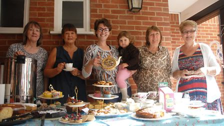 Harriet White (centre) owner of Re-Shape gym in Saffron Walden with members at the Macmillian Coffee