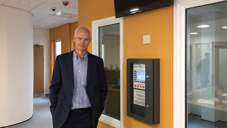 Barry Chandler, practice manager at The Stansted Surgery, in the new reception area