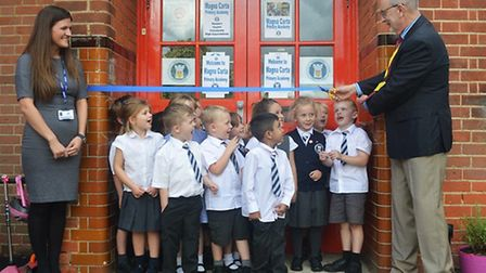 Councillor Ray Gooding officially open Magna Carta School in Stansted, watched by pupils and head of