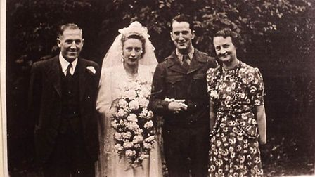 Audrey and Robert Paschal on their wedding day with her parents, Arthur and Nellie Ridgewell.