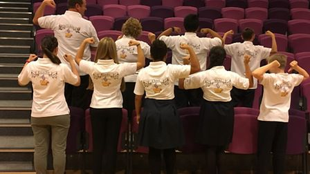 The team display their specially made T-Shirts