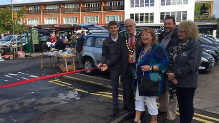 Cutting the ribbon on the first Letchworth town centre car boot sale on Sunday. Left to right: Letch