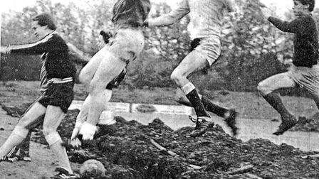 Stevenage players using the trench dug across the Broadhall Way pitch as an obstacle during a traini