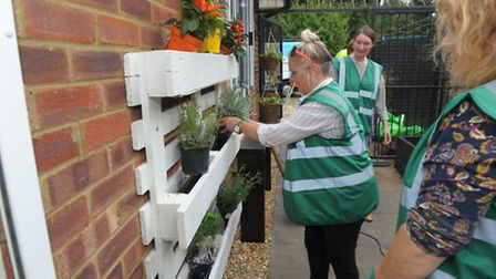 Volunteers at work during the Howard Garden Social Centre makeover.