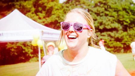 Rebecca Gray running in the Colour Clash in aid of Garden House Hospice Care.