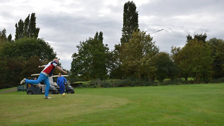 Martin McMahon hurls a golf club during the Adrian Gray memorial golf day at Cambidge Meridian Golf