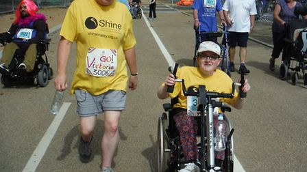 Victoria Nice uses the handcrank attachment to her wheelchair to power herself 5km around the Olympi