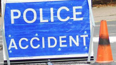 Police have closed London Road near Hitchin after a van hit a deer and went into a hedge.