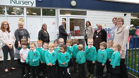 The chairman of North Herts District Council, Councillor John Booth, opens the new nursery at the Ga