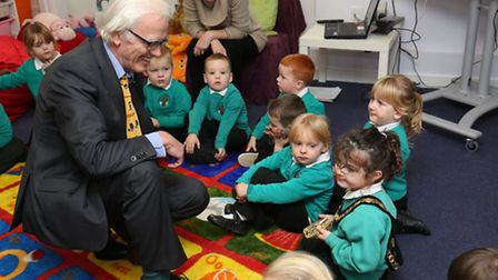 The chairman of North Herts District Council, Councillor John Booth, meets children at the opening o