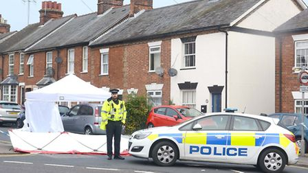 A police officer stands guards at the scene of the stabbing in Hitchin.