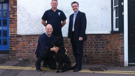 From right, Stevenage MP Stephen McPartland, retired police dog trainer Mark Tasker and guide dog ow