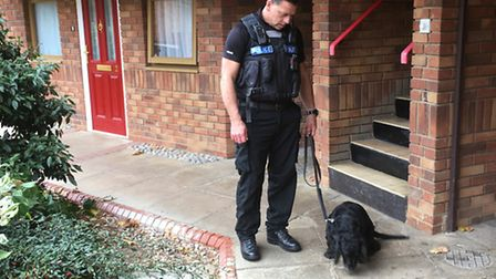 PC Andy Blacklock and police dog Max searched the homes for drugs.