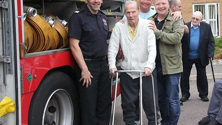 Eric Cross with firefighters