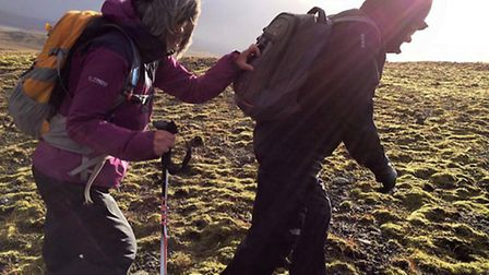 Fazilet Hadi, left, during her trek across Iceland for the Royal National Institute of Blind People.
