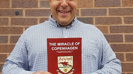 Journalist and author Layth Yousif with his book The Miracle of Copenhagen
