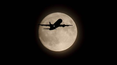 Ian Harris snapped this striking shot of a plane in front of the supermoon from his Stevenage garden