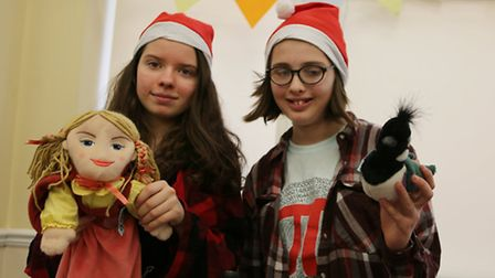 Left to right: Eira Bagenal, 14, and Hilary Bexfield, 12, with their tombola stall.