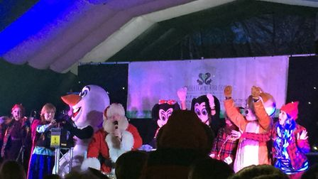 Father Christmas and his assorted helpers get set for the big switch-on.