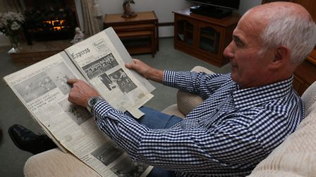 Derek Charlie Turner with a newspaper report and pictures from the 1962 game against Arsenal in whic